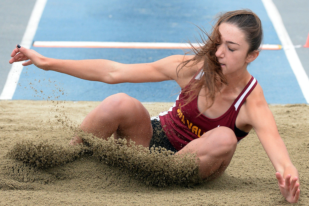 Description of . Simi Valley's Madisen Richards competes in the Division 2 long jump during the CIF Southern Section track and final Championships at Cerritos College in Norwalk, Calif., on Saturday, May 24, 2014. 