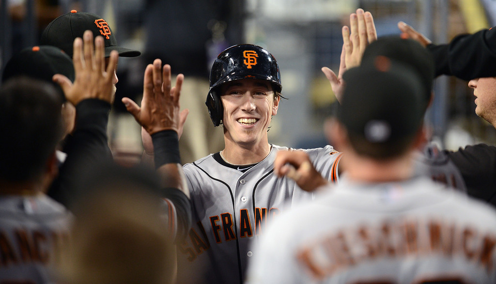 Description of . Giants' pitcher Tim Lincecum #55 enters the dugout after scoring in the 3rd inning during their game against the Dodgers at Dodgers Stadium Saturday, September 14, 2013. (Photo by Hans Gutknecht/Los Angeles Daily News)