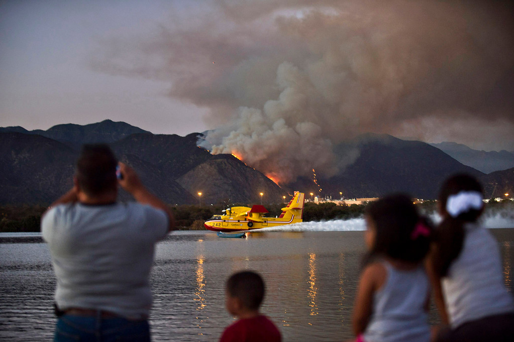 Description of . A Super Scooper refills its water from Santa Fe Dam Recreational Area while battling a fire in Azusa Canyon on Monday evening, Sept. 23, 2013. (Photo by Watchara Phomicinda/ San Gabriel Valley Tribune)