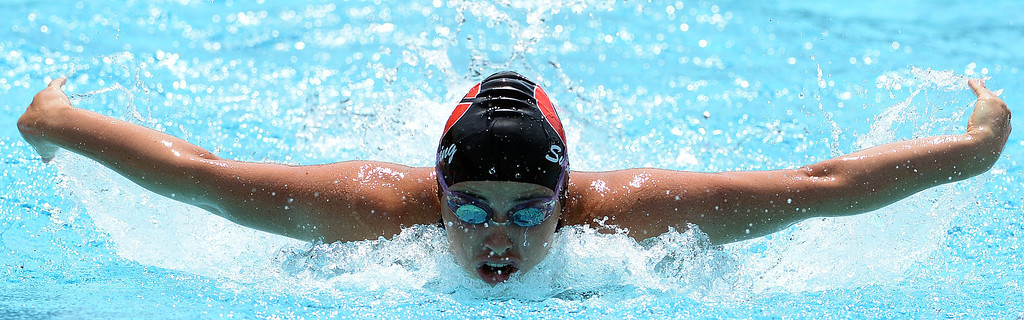 Description of . Glendora's Alexis Margett wins the 100 yard butterfly during the Division 2 CIF Southern Section Swimming Championships in the Riverside Aquatics Complex at Riverside City College in Riverside, Calif., on Saturday, May 17, 2014.