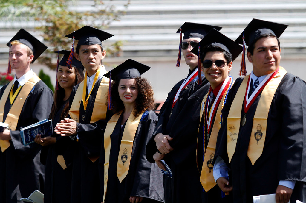 Description of . Graduates that received Scholastic Achievement Awards stand for recognition, during the Citrus College 97th Commencement Ceremony, at Citrus College Stadium, in Glendora, Saturday, June 15, 2013. (Correspondent Photo by James Carbone/SVCITY)