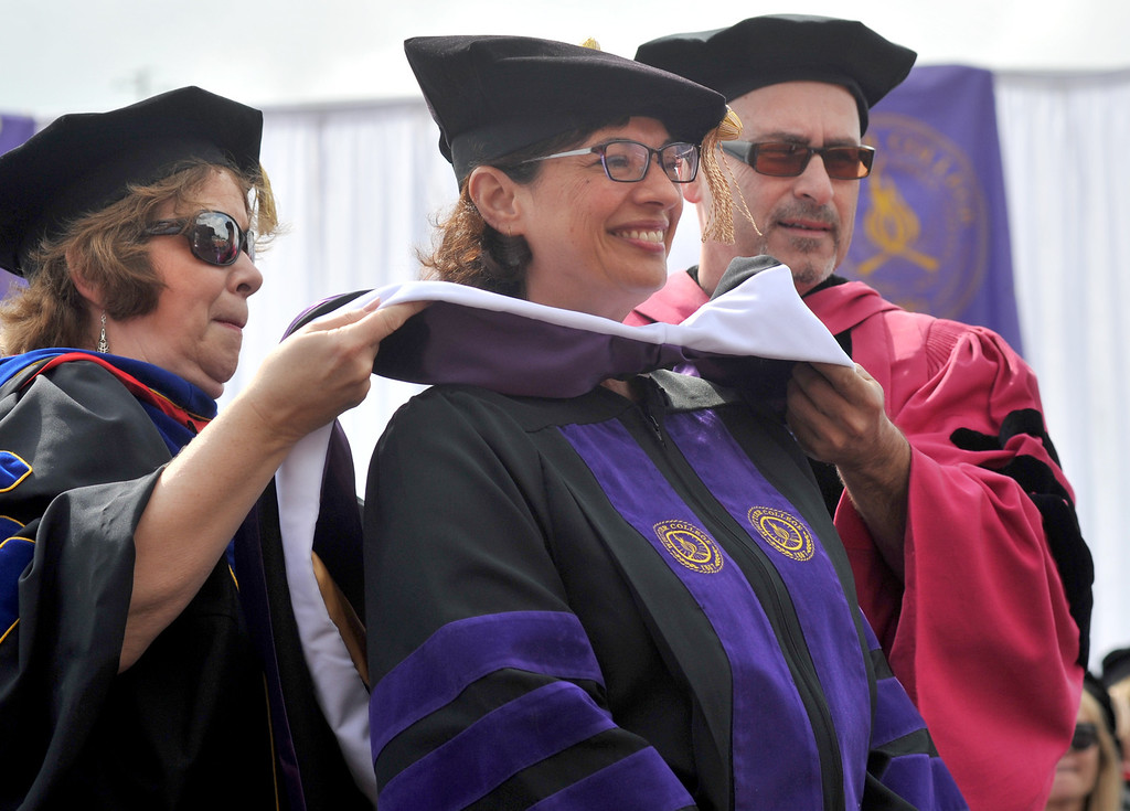 Description of . Commencement Speaker, Sonia Nazario, receives an honorary doctorate degree during the 110th Commencement Ceremony at Memorial Stadium on the Whittier College campus in Whittier on Friday May 17, 2013. Award-winning journalist Sonia Nazario gave the keynote address and received an honorary degree from the Whittier College faculty: a doctorate of humane letters.(SGVN/Staff Photo by Keith Durflinger)