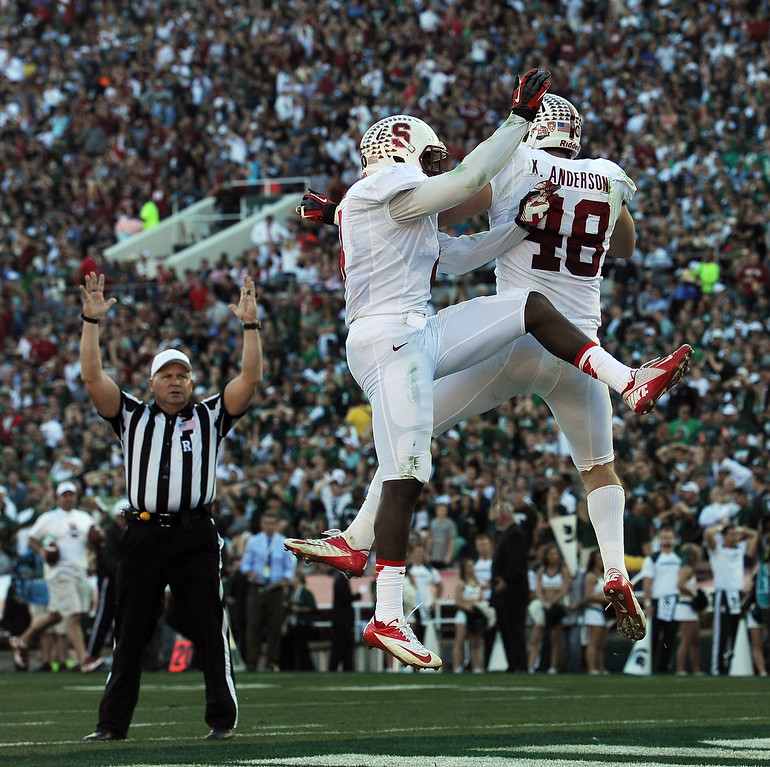 Description of . Stanford's Kevin Anderson #48 celebrates his interception for a touchdown with Jordan Richards #8  in the 2nd quarter against Michigan State during the 100th Rose Bowl game in Pasadena Wednesday, January 1, 2014. (Photo by Hans Gutknecht/Los Angeles Daily News)