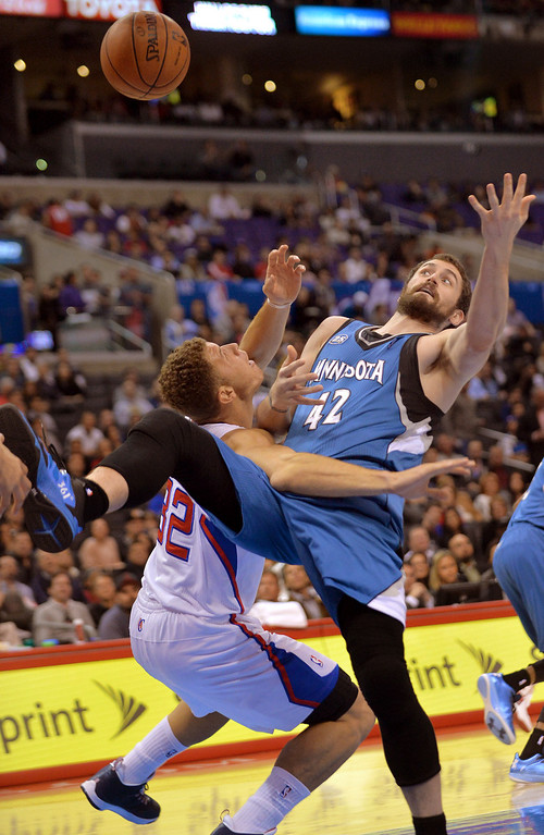 Description of . Los Angeles Clippers' Blake Griffin and Kevin Love of the Minnesota Timberwolves' battle under the hoop duirng the first half Monday, Nov. 11, 2013, in Los Angeles.(Andy Holzman/Los Angeles Daily News)