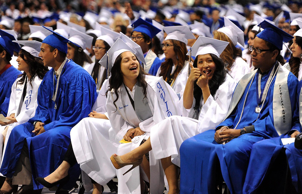 Description of . Students prepare to receive diplomas during Rialto High School Commencement Exercises held at Citizens Bank Arena in Ontario June 2, 2013.  The school graduated 570 seniors.  GABRIEL LUIS ACOSTA/STAFF PHOTOGRAPHER.