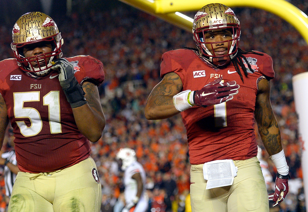 Description of . Florida State's Kelvin Benjamin reacts after scoring the winning touchdown against Auburn during the 2014 Vizio BCS National Championship January 6, 2014 in Pasadena CA.  Florida State won the game 34-31.(Andy Holzman/Los Angeles Daily News)