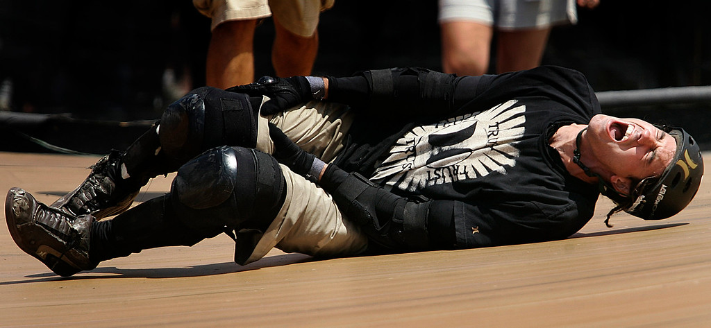 Description of . Bob Burnquist of Vista,Calif., in severe pain as he crashes on his 2nd to last run during the Skateboard Big Air Finals during the Eleventh X Games at Staples Center in Los Angeles ,Calif., August 7. 2005.   (Pasadena Star-News Staff Photo Keith Birmingham/SXSports)