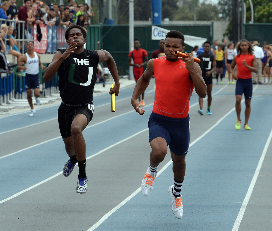 Description of . Upland's Mekai Sheffie, left, along with Great Oak's Laquan Williams runs the final leg of the division 4 4x100 meter race during the CIF Southern Section track and final Championships at Cerritos College in Norwalk, Calif., Saturday, May 24, 2014. 