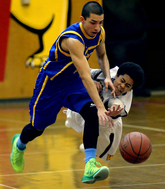 Description of . Wilson's Kyle Price (3) dives for a loose ball past San Dimas' Elias Hernandez (12) in the first half of a prep basketball game at Wilson High School in Hacienda Heights, Calif., on Friday, Jan. 31, 2014. (Keith Birmingham Pasadena Star-News)