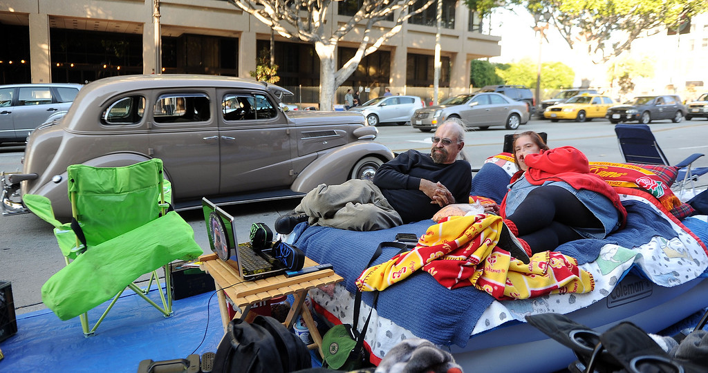 Description of . Peter and Patricia Canon of San Pedro camp out with an air mattress, television and heat for the Rose Parade along Colorado Boulevard in Pasadena, Calif., on Tuesday, Dec. 29, 2013.     (Keith Birmingham Pasadena Star-News)