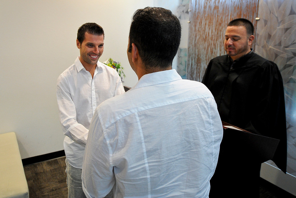 Description of . Christopher Persky, 32, left, and his partner of 10 years Ken Bencomo, 45, both of Rancho Cucamonga, get married at the San Bernardino County Hall of Records in San Bernardino on Monday, July 1, 2013. (Rachel Luna / Staff Photographer)