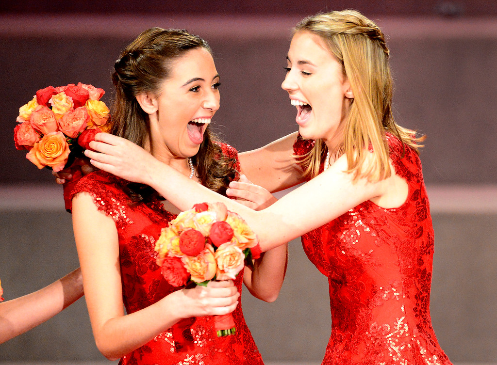 Description of . Princess Katherine Lipp, right, congratulates Ana Acosta as she is named the 96th Rose Queen during the Tournament of Roses' coronation ceremony Thursday night, October 24, 2013 at the First Church of the Nazarene of Pasadena. (Photo by Sarah Reingewirtz/Pasadena Star-News)