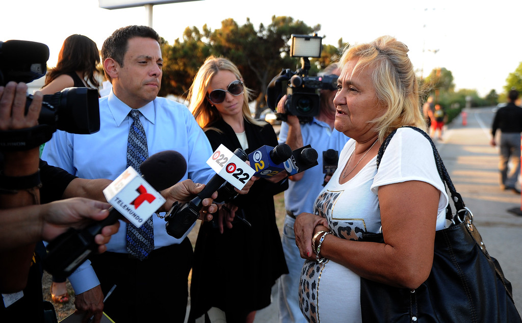 Description of . Maria Montes, a family friend of the children who were killed speaks to reporters in front of a make shift memorial for a Man and two children who were killed in a late Thursday night crash along the 3500 block of San Gabriel River Road on Friday, June 14, 2013 in Industry, Calif. Three others were injured in the crash.  (Keith Birmingham/Pasadena Star-News)