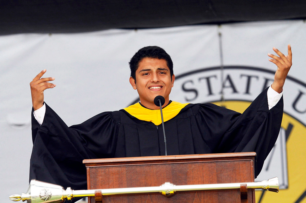 Description of . Hector Escobar, President, Associated Students, Inc., during the  California State University, Los Angeles, Sixty-Sixth Graduate and Undergraduate Commencement Ceremony, at California State University Athletic Stadium, in Los Angeles, Saturday, June 15, 2013. (Correspondent Photo by James Carbone/SXCITY)