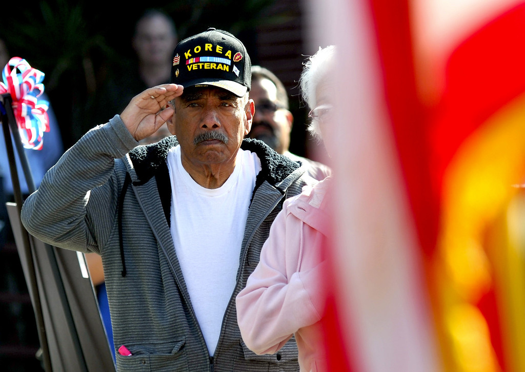 Description of . Veterans salute as the national anthem is performed during the Veterans Day Celebration at El Monte City Hall on Monday November 11, 2013. Veterans are honored with speaches and music and a flag ceremony. (San Gabriel Valley Tribune/Staff Photo by Keith Durflinger)