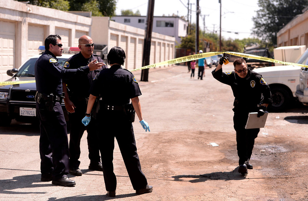Description of . Pomona Police investigate the scene of a double-shooting along the 300 block of Orchid Lane in Pomona August 11, 2013.   GABRIEL LUIS ACOSTA/STAFF PHOTOGRAPHER.