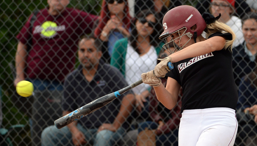 Description of . La Serna's Molly Bourne singles in the second inning of a prep playoff softball game against Bishop Amat at Bishop Amat High School in La Puente, Calif., on Thursday, May 22, 2014. La Serna won 6-0.   (Keith Birmingham/Pasadena Star-News)
