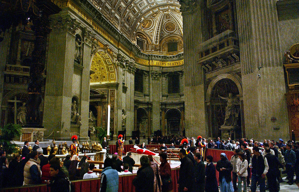 Description of . The body of Pope John Paul II lies in state in Saint Peter's Basilica in Vatican City on Monday, April 4, 2005. In a slow, solemn ceremony the pope's body was moved from the Apostolic Palace in Vatican City to St. Peter's Basilica on Monday where it will lie in state for public viewing before his funeral on Friday.  (Lynsey Addario/The New York Times)