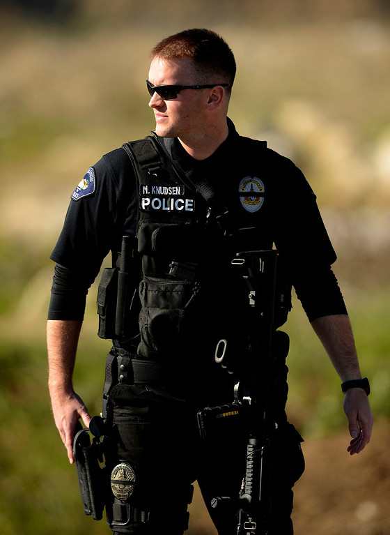Description of . Redlands Police Redlands Police Officer K. Knudsen stands guard at a blockade along Highway 38 and Bryant Street near the Mill Street Ranger Station west of Yucaipa February 12, 2013.  Authorities believe that they exchanged gunfire with fugitive Christopher Dorner in the Angles Oaks area of the San Bernardino National Forest.  Fish and Game officers spotted a man fitting the description of Dorner driving a white pick-up and  exchanged gunfire with him. (Staff photo by Gabriel Luis Acosta/The Sun)