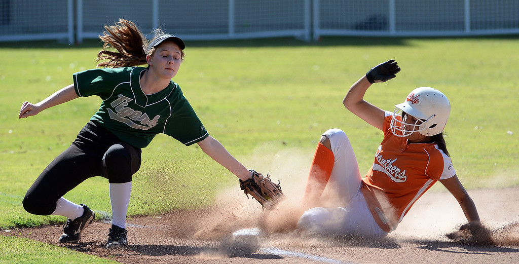 Description of . Poly's Shalini Haupt save at third base under the tag of Westridge's Grace Wallis in the first inning of a prep softball game at Westridge High School in Pasadena, Ca on Tuesday, April 15, 2014. Poly won 11-1. (Keith Birmingham Pasadena Star-News)