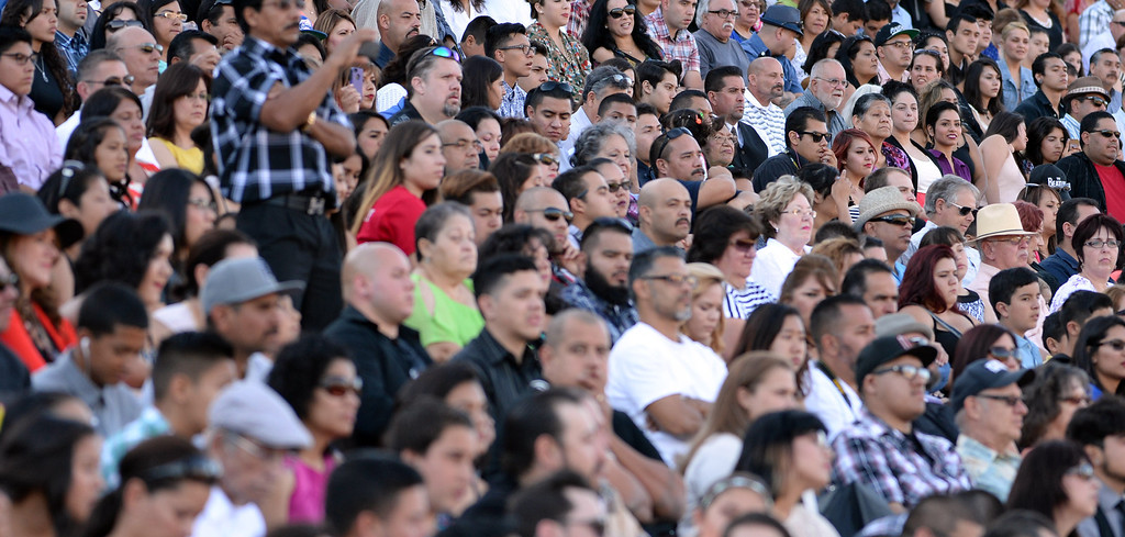 Description of . Family and friends look on during the Whittier High School graduation at Whittier College in Whittier, Calif., on Wednesday, June 4, 2014.  (Keith Birmingham/Pasadena Star-News)