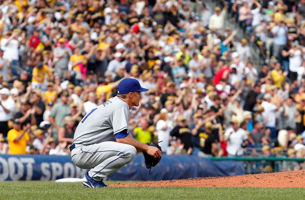 Description of . Zack Greinke #21 of the Los Angeles Dodgers reacts after giving up a three-run home run to Pedro Alvarez #24 of the Pittsburgh Pirates in the fifth inning during the game on June 16, 2013 at PNC Park in Pittsburgh, Pennsylvania.  Pirates won 6-3.   (Photo by Justin K. Aller/Getty Images)