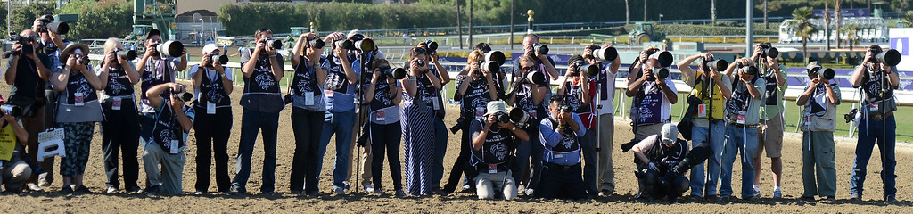 Description of . Photographers wait for Jockey Martin Garcia (not pictured) atop