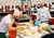 March 19,2013. Las Vegas NV. USA. Pizza chef's   are watch by the judges in the international pizza challenge during the world pizza games at the 2013 International Pizza Expo.