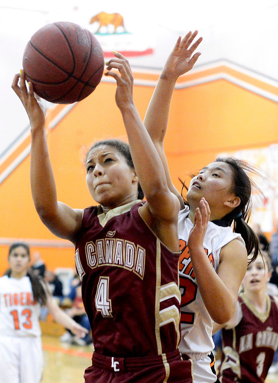 Description of . La Canada's Marie Weston (4) gets a rebound during South Pasadena's 66-58 win Friday night, January 31, 2014 at South Pasadena High School. (Photo by Sarah Reingewirtz/Pasadena Star-News)