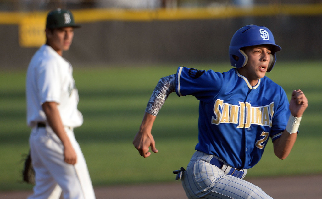 Description of . San Dimas' Josh Avila (C) (2) scores on a single by Logan Murratalla (C) (not pictured) in the first inning of a prep baseball game against Bonita at Bonita High School in La Verne, Calif., on Wednesday, March 19, 2014.  (Keith Birmingham Pasadena Star-News)