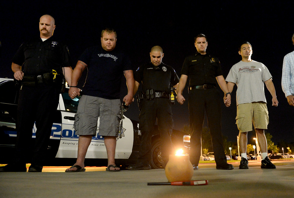 Description of . A vigil was held for wounded San Bernardino Police officer Gabriel Garcia in front of Arrowhead Regional Medical Center in Colton, Ca., Friday, August 22, 2014. Garcia is being treated at the hospital after suffered two gunshot wound to the upper torso during an early morning shoot out in San Bernardino. (Photo by John Valenzuela/ The Sun)