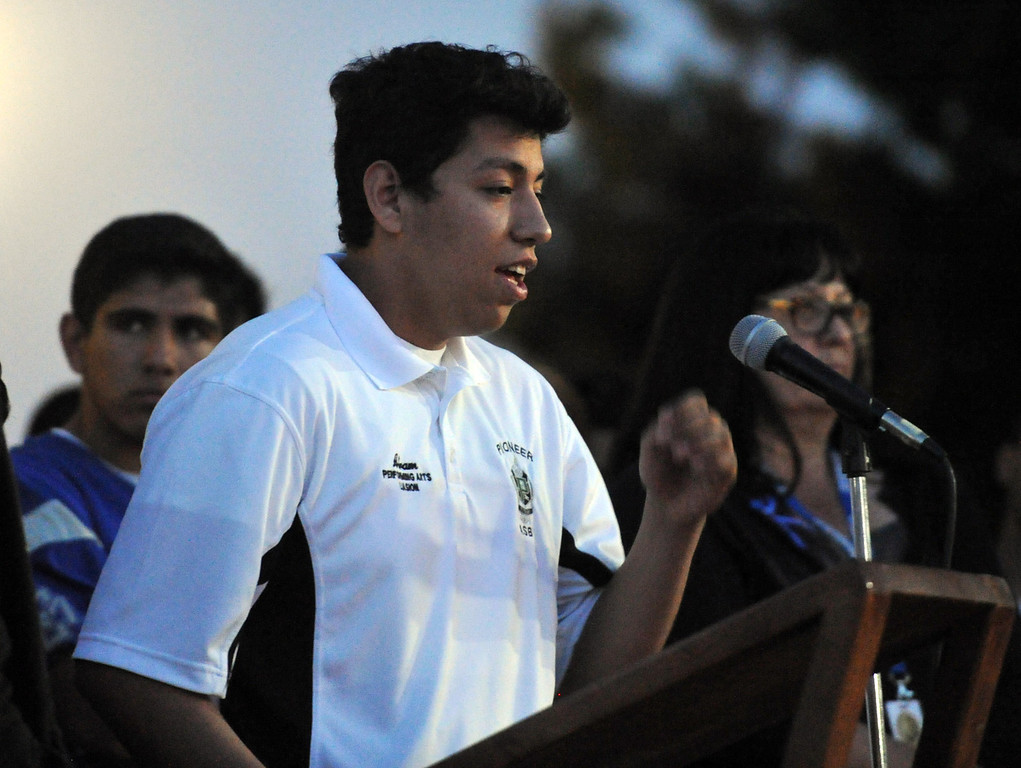 Description of . Pioneer High School student, Abram Garcia, a student who was on the bus when it crashed, cries as he tells the story to family, students and members of the community gather in memory of Adrian Castro, 19, at El Monte High School Monday evening April 14, 2014. Castro was one of nine students killed in the bus crash in Orland, Calif. (Staff Photo by Keith Durflinger/San Gabriel Valley Tribune)