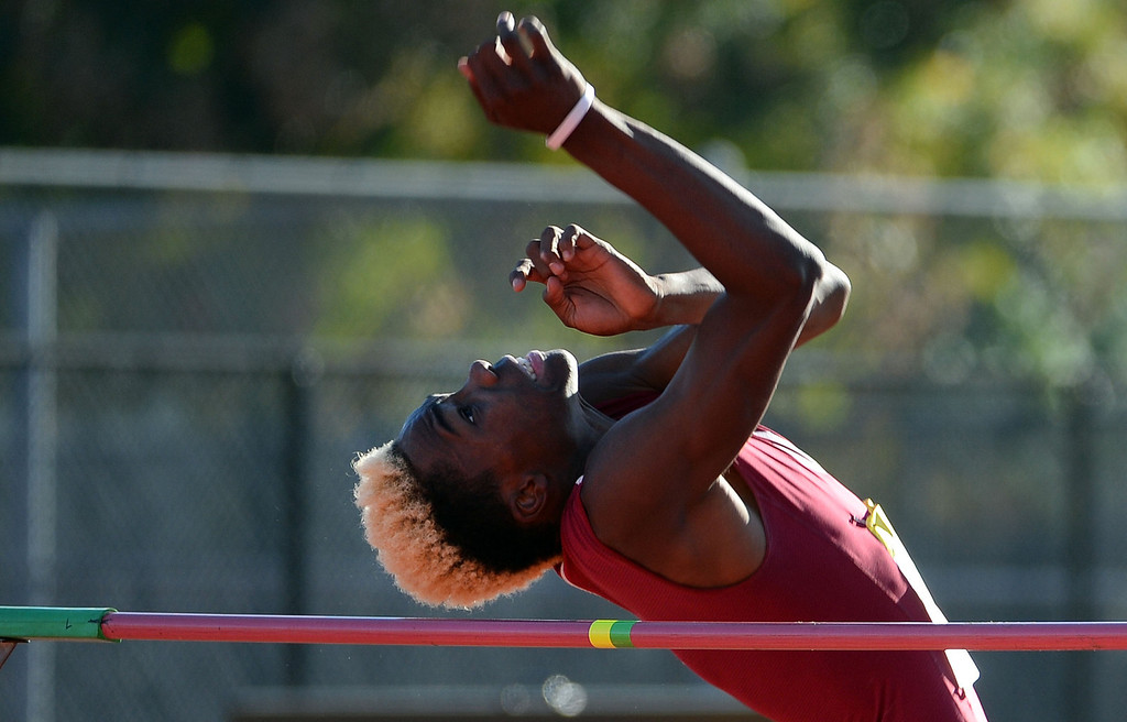 Description of . Covina's D'Juan Shamburger competes in the high jump during the Arcadia Invitational track and field meet at Arcadia High School in Arcadia, Calif., on Friday, April 11, 2014.  (Keith Birmingham Pasadena Star-News)