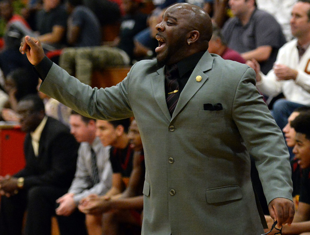 Description of . Ontario head coach Richard Johnson in the first half of a prep playoff game against Pasadena at Pasadena High School in Pasadena, Calif., on Friday, Feb.21, 2014. (Keith Birmingham Pasadena Star-News)