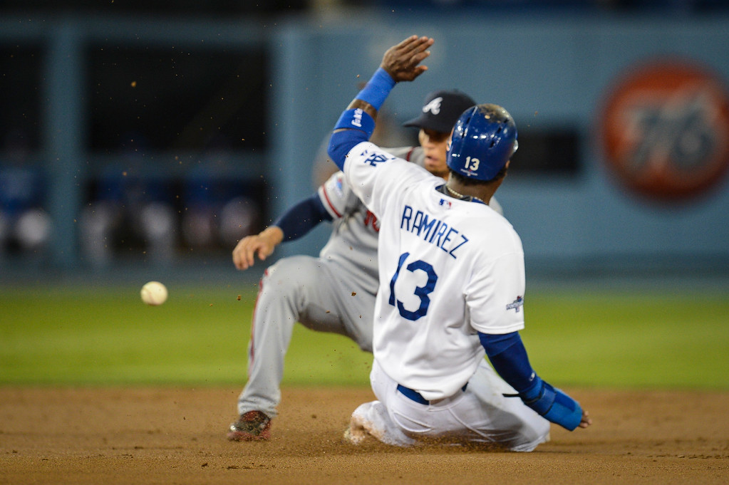 Description of . Dodgers' Hanley Ramirez is safe at second as Atlanta's Elliot Johnson can't make the play in time during first inning action in game 4 Monday, October 7, 2013 ( Photo by Hans Gutknecht/Los Angeles Daily News )