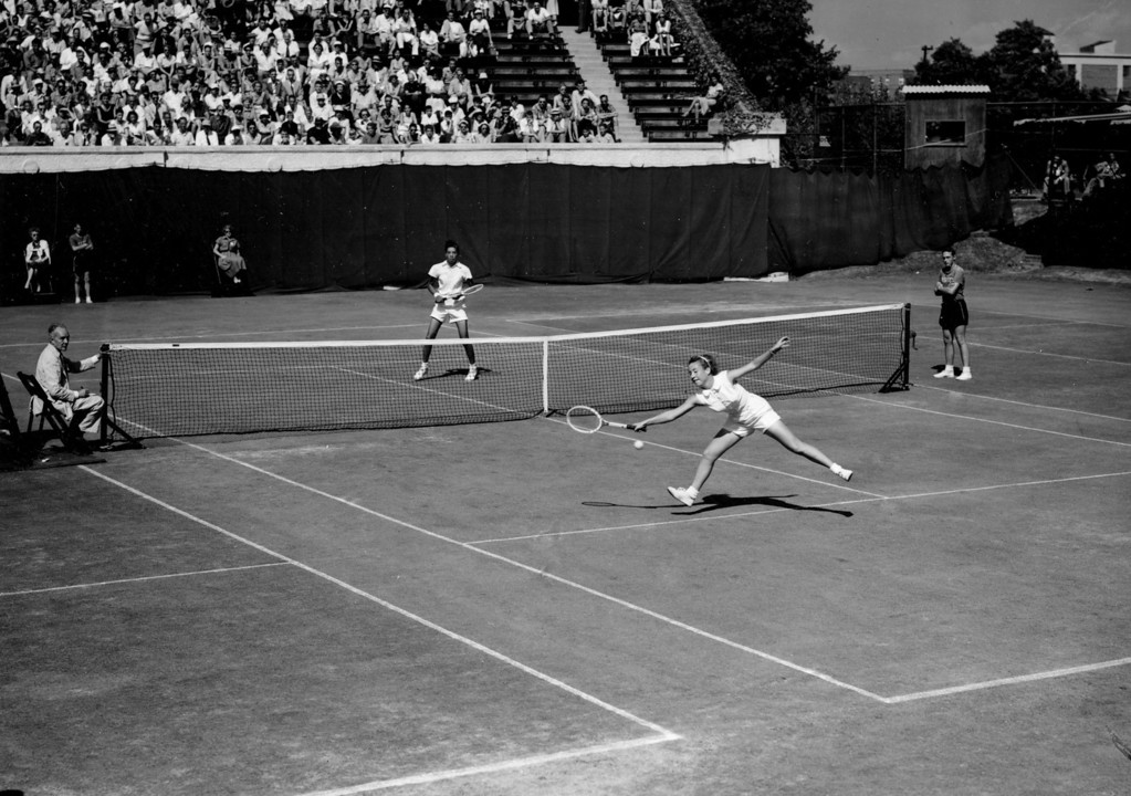 "Description of . Maureen ""Little Mo\"" Connolly fails to return the ball to Althea Gibson in the National Tennis championships at Forest Hills in Queens, N.Y., on Sept. 5, 1953.  Connolly, the defending champion from San Diego, Ca., gained the semi-finals with a 6-2, 6-3 victory over Gibson of New York.  (AP Photo)"