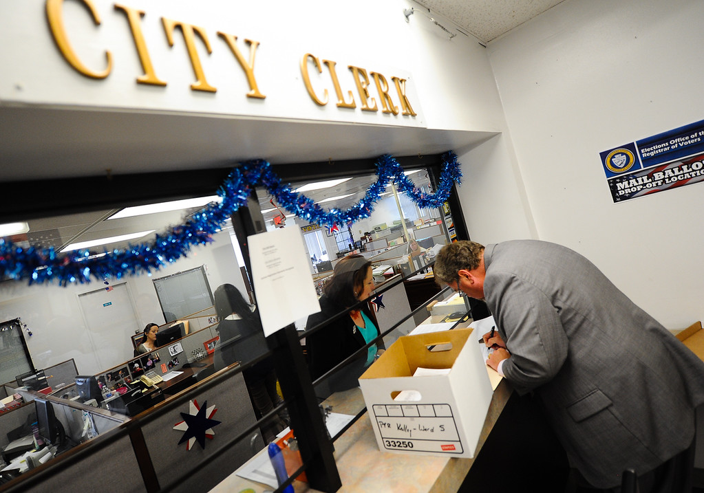 Description of . Recall proponent Scott Beard files recall petitions with City Clerk Gigi Hanna at San Bernardino City Hall on Thursday, Aug. 22, 2013. On Thursday, San Bernardino County Superior Court Judge David Cohn ordered Hanna to count the petitions to recall City Attorney James F. Penman and several City Council members. (Rachel Luna / Staff Photographer)