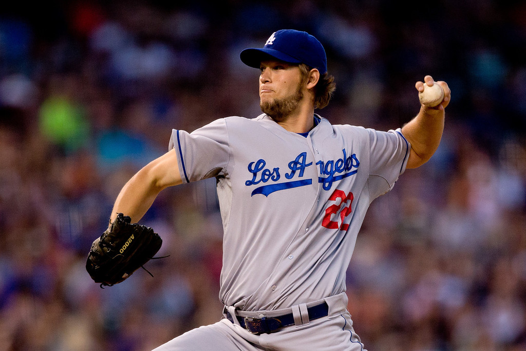 Description of . Starting pitcher Clayton Kershaw #22 of the Los Angeles Dodgers delivers to home plate during the sixth inning against the Colorado Rockies at Coors Field on July 2, 2013 in Denver, Colorado.  Kershaw threw a complete game shutout, helping the Dodgers defeat the Rockies 8-0. (Photo by Justin Edmonds/Getty Images)