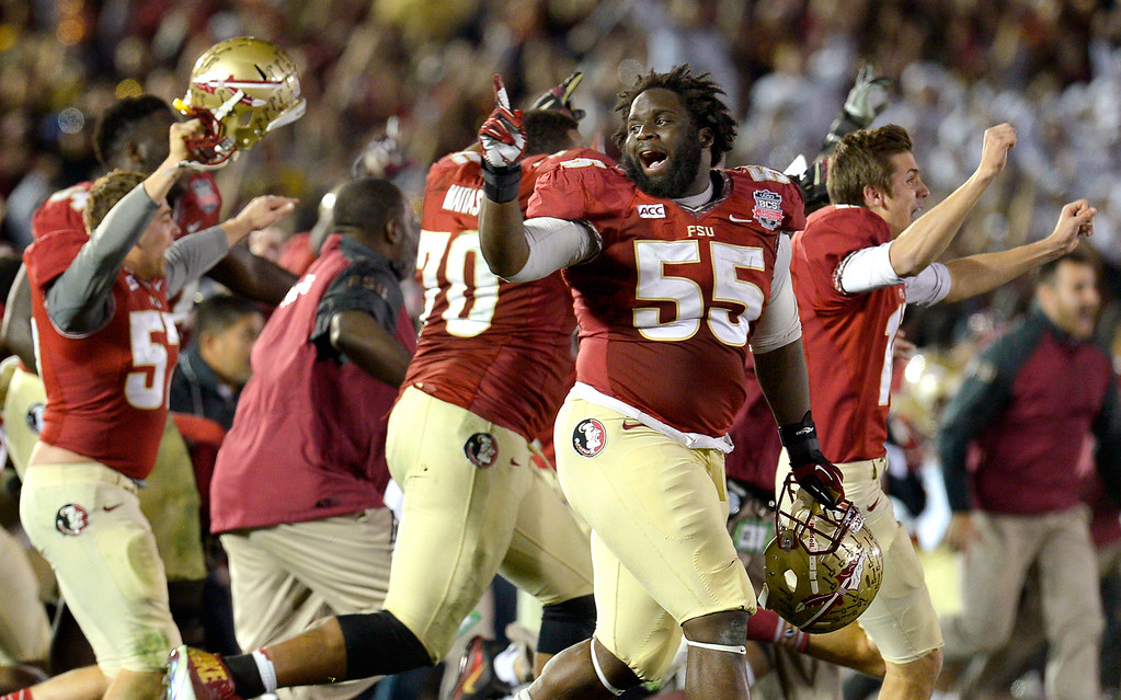 Description of . Florida State players make their way onto the field as the clock expires against Auburn during the 2014 Vizio BCS National Championship January 6, 2014 in Pasadena CA.  Florida State won the game 34-31.(Andy Holzman/Los Angeles Daily News)
