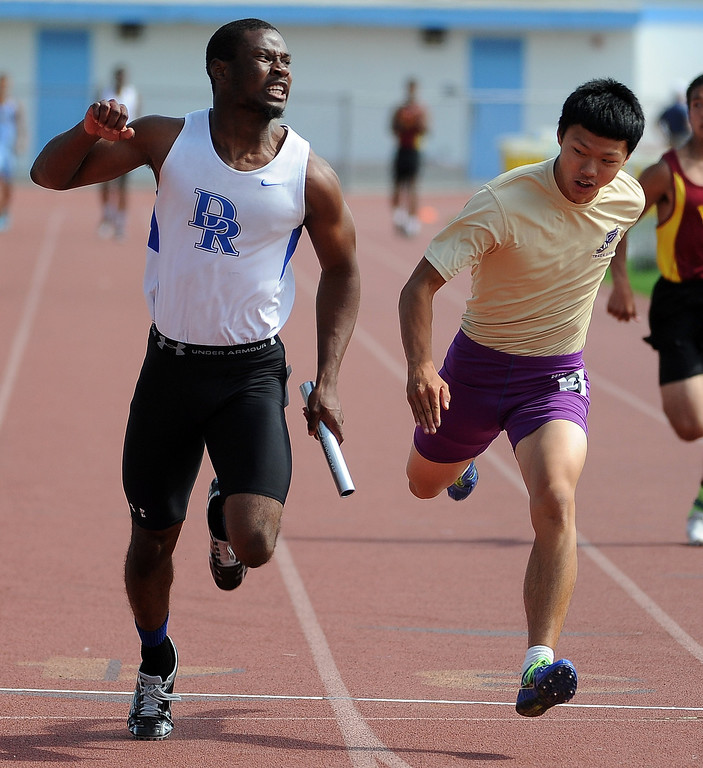 Description of . Diamond Ranch's Will Bryan, left, finishes first ahead of Diamond Bar's Ryan Gan, right, during the 4x100 relay during the Hacienda League track finals in Walnut, Calif., on Thursday, May 8, 2014.  (Keith Birmingham Pasadena Star-News)
