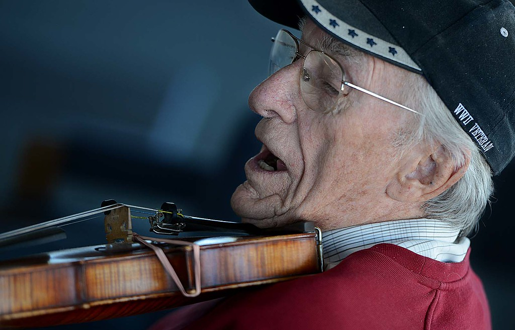Description of . Bill Williams, 91, plays the violin with a group of fellow World War II Veterans. The Redlands Airport Philharmonic gather each Wednesday in the lobby of the Redlands Airport to share stories, coffee, donuts and