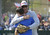 LONG BEACH, CALIF. USA -- 	Los Altos Youth Baseball and Softball league president, Dwayne Fowler, hugs his oldest son, Andrew Fowler, after Andrew delivered one of three first pitches during opening ceremonies at El Dorado Park in Long Beach, Calif. on March 2, 2013. Fowler's other children, Jacob Fowler and Makayla Fowler delivered the other first pitches. Their mother, Colette Fowler, who was in charge of the snack bar and was a huge part of the league, died of cancer last September.  Photo by Jeff Gritchen / Los Angeles Newspaper Group