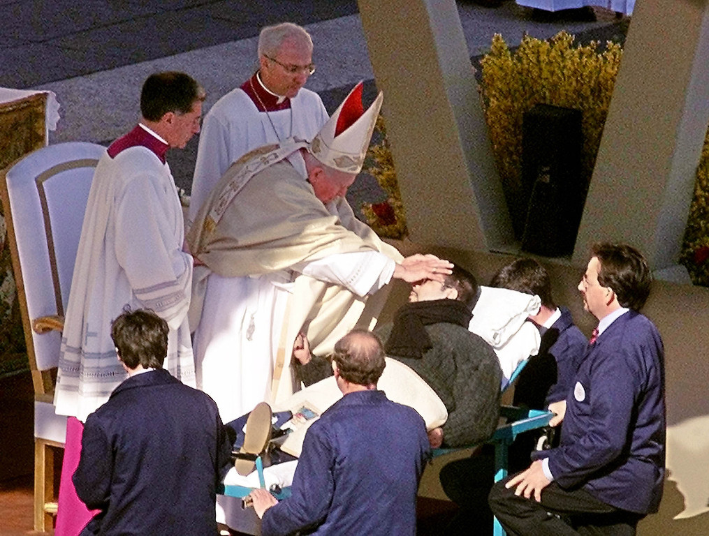 Description of . Pope John Paul II gives a special blessing by placing his two hands on the head of a man who was carried  on a stretcher up the steps of St. Peter's Basilica during an open-air special Jubilee Celebration for the Sick and for Health Care Workers in St. Peter's square at the Vatican in this Feb. 11 2000 file photo.  Bit by bit over his 26-year papacy, John Paul has built a rich body of reference about the final stages of life. Its pillars include categorical rejection of euthanasia, insistence on treatments that help people bear ailments with dignity and encouragement of research to
