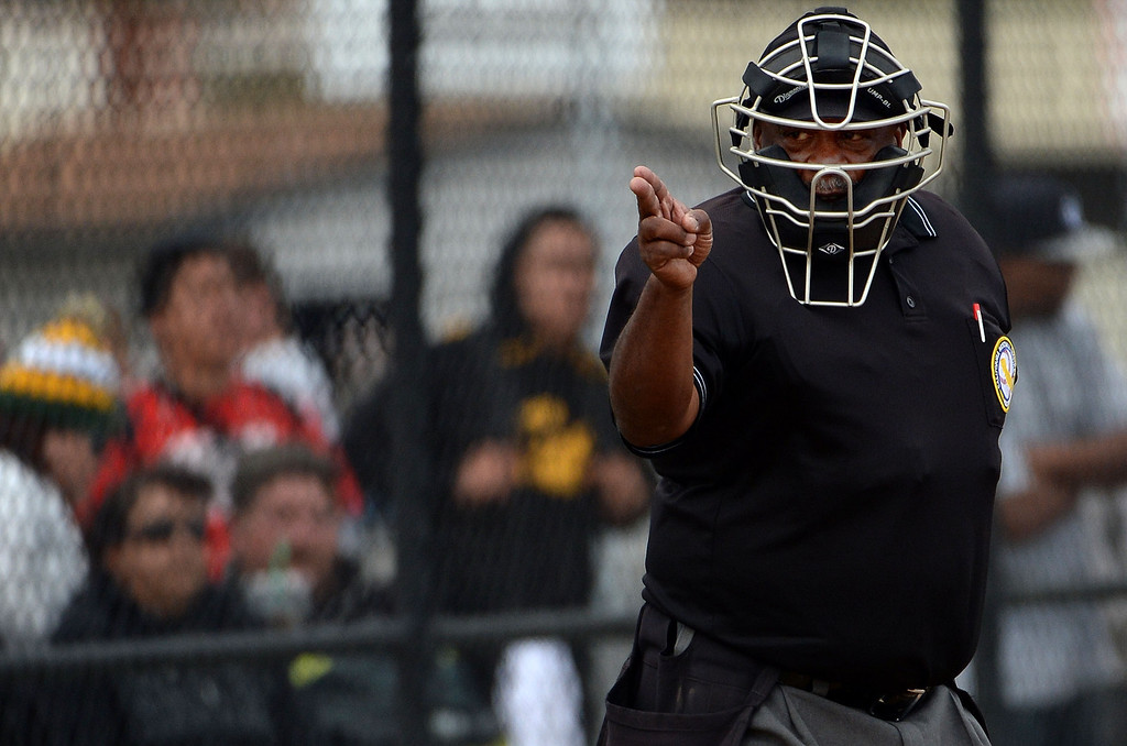 Description of . Home plate umpire calls a strike in the fifth inning of a prep baseball game between San Dimas and Northview at Northview High School in Covina, Calif., on Wednesday, March 26, 2014. San Dimas won 2-0.