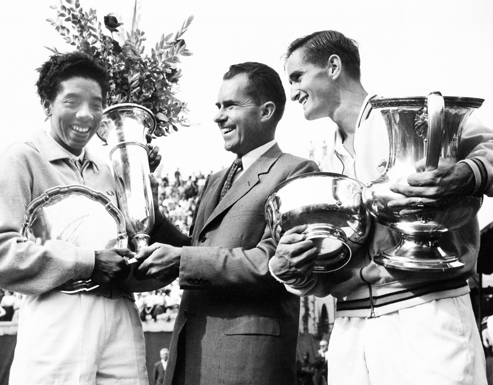 Description of . Vice President Richard Nixon presents winners\' trophy to New York\'s Althea Gibson, the first black woman ever  to win the National Tennis Championships women\'s title in Forest Hills, N.Y., Sept. 8, 1957.  At right is Mal Anderson of Australia, winner in the men\'s division.  (AP Photo/Harris Harris)
