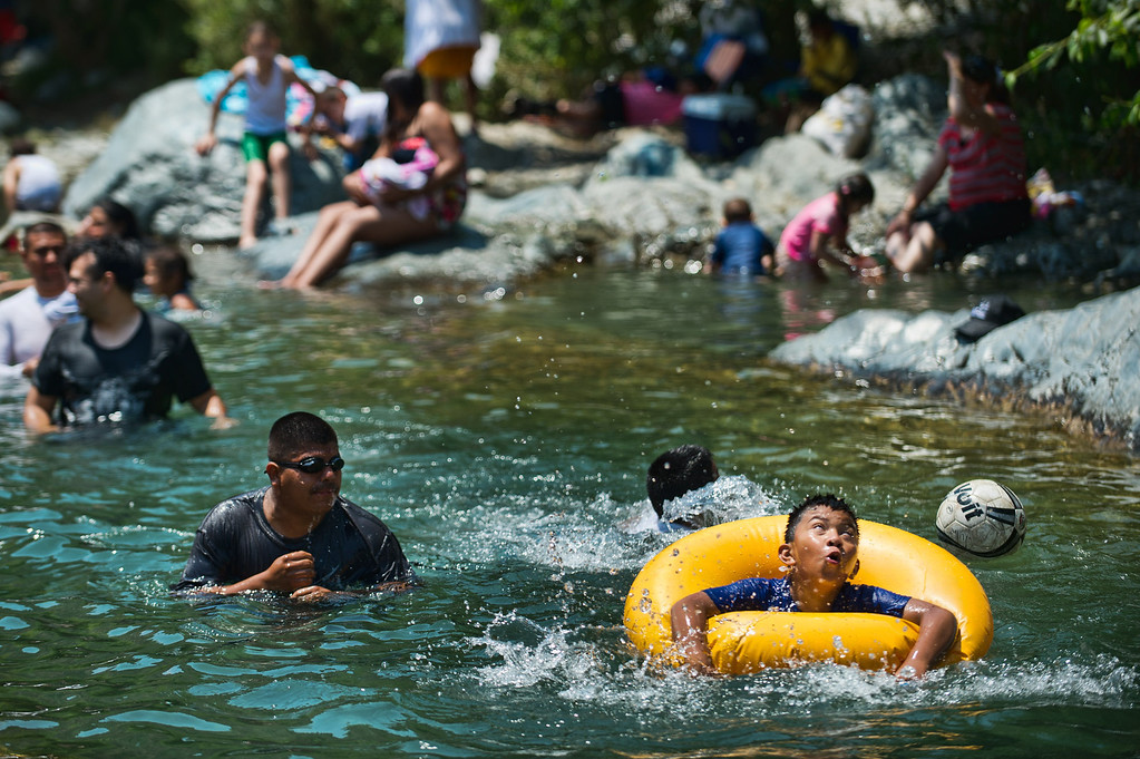Description of . People enjoy a hot day in San Gabriel River in the East Folk area of Angeles National Forest above Azusa on Wednesday, July 3, 2013. (Photo by Watchara Phomicinda)
