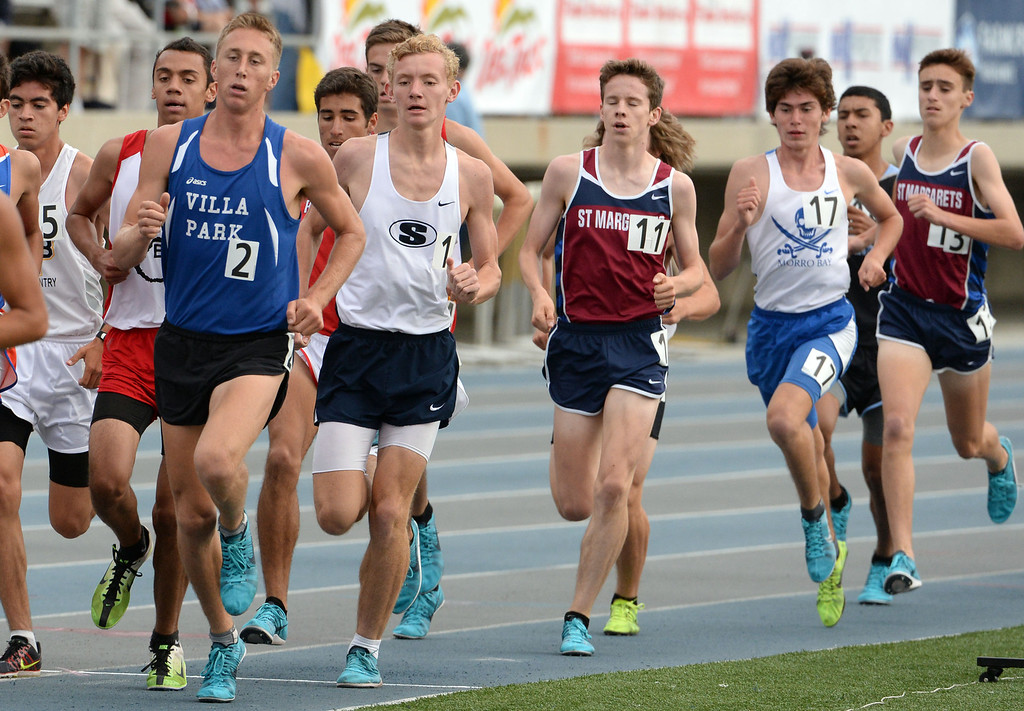 Description of . Saugus's  Brian Zabilski, second from left, competes in the division 2 3200 meter run during the CIF Southern Section track and final Championships at Cerritos College in Norwalk, Calif., Saturday, May 24, 2014. 