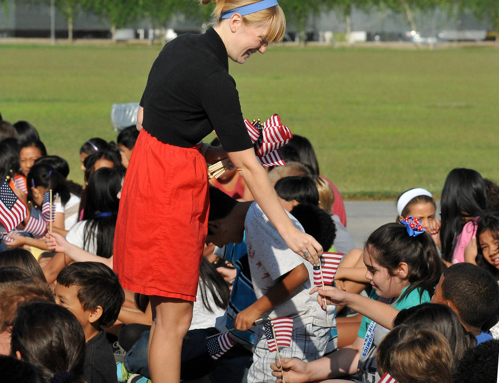 Description of . (John Valenzuela/Staff Photographer) Jessica Neilson hands-out American flags at Mission Elementary in Redlands during the schools Patriot's Day celebration, marking the 12th Anniversary of the 9/11 attacks, Wednesday, September 11, 2013. Kafader discussed the tragic events that happen on Sept. 11, 2001, when nearly 3000 people were killed during the terrorist attacks 12 years ago.