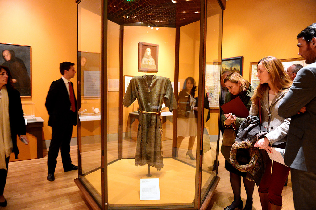 Description of . The Spanish press view the 18th century Tunic of Fray Antonio Margil de Jesus in the Junipero Serra exhibition at The Huntington Library in San Marino Saturday night, November 16, 2013 as they wait for The Crown Prince Felipe and Princess Letizia of Spain during their visit to The Huntington. (Photo by Sarah Reingewirtz/Pasadena Star-News)