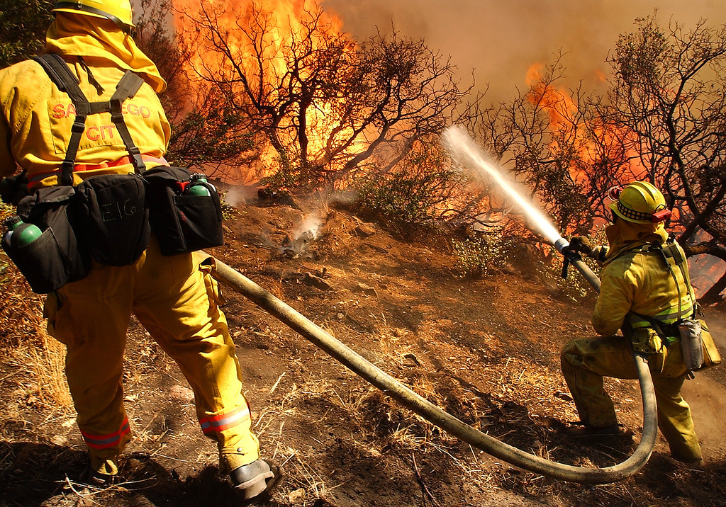 Description of . Ten years ago this month the arson caused Old Fire, fanned by Santa Ana winds burned thousands of acres, destroyed hundreds of homes and caused six deaths. The fire burned homes in San Bernardino, Highland, Cedar Glen, Crestline, Running Springs and Lake Arrowhead and forced the evacuation of thousand of residents. San Diego City firefighters work to keep fire off the ridge line where homes are during the